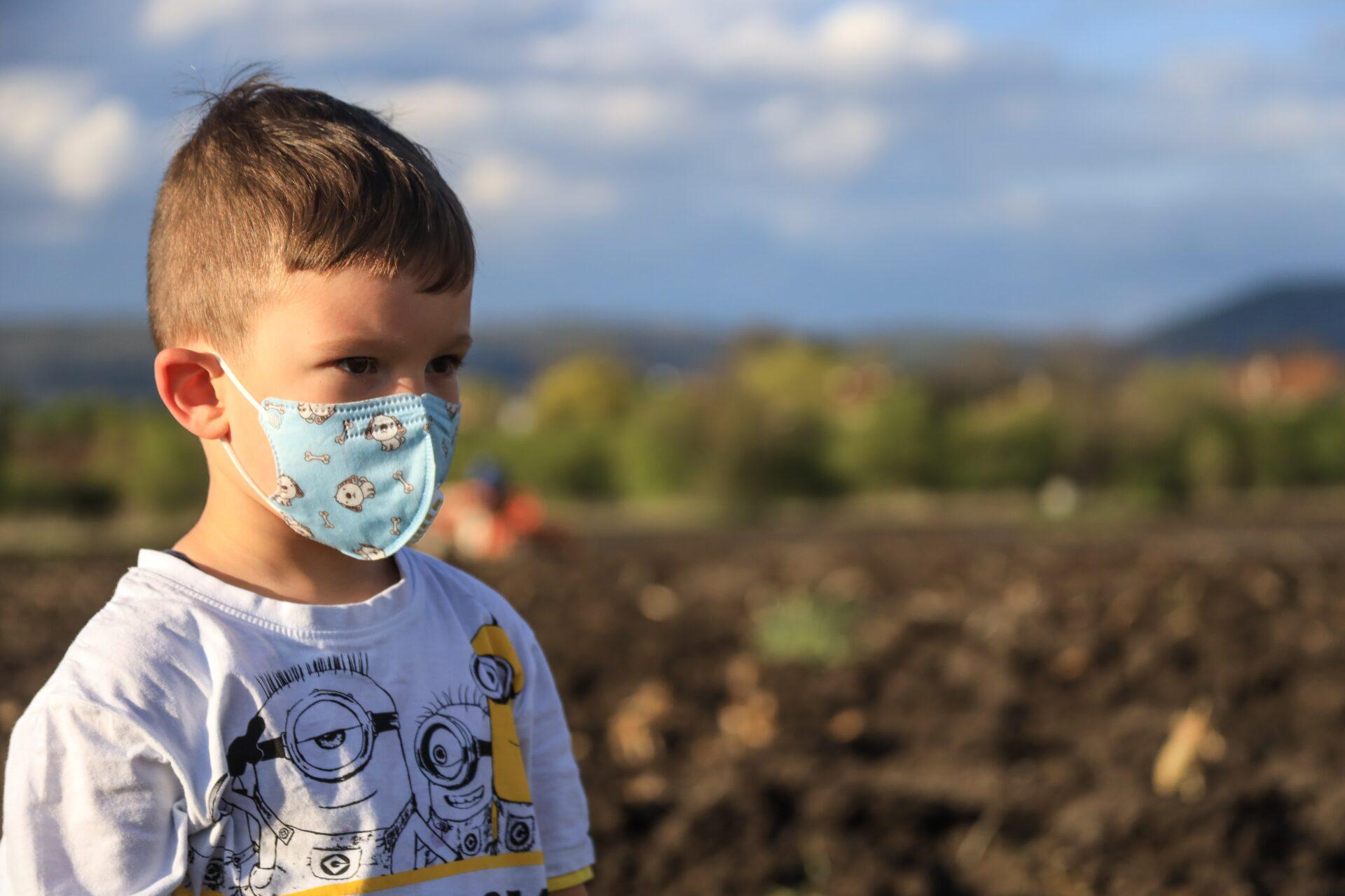 little boy wearing a mask